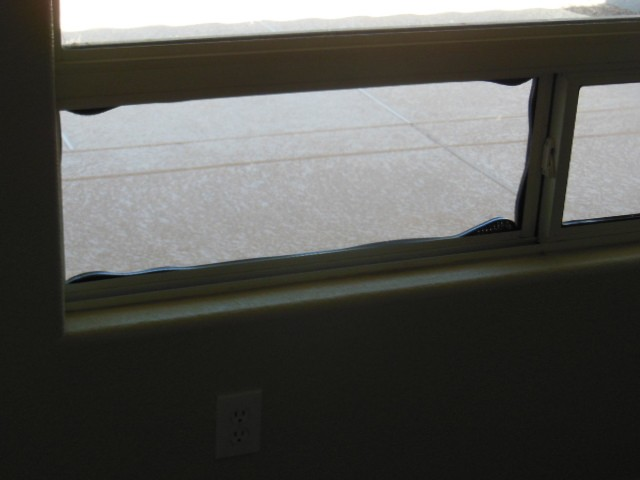 We call this creeping window seals. This is caused when thermal pane windows are in constant exposure to the sun. Eventually the seals become compromised and the thermal rating of the window is gone. Your utility bill will begin to increase if this is not corrected.