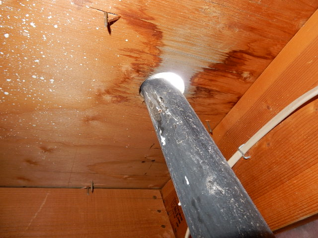 From the rooftop you can see this vent pipe is not flashed properly and in the attic you can see water intrusion from this poor workmanship.