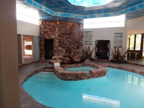 Can we inspect pools? We do them all! Here is an indoor pool of a high tech home with elaborate water features.